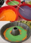 Divide batter into 3 bowls. Mix in colors. Layer in pan
